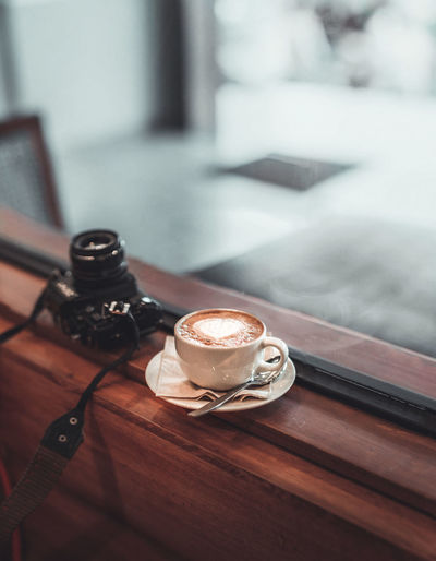 A cup of coffee and film #35mm #coffee #cappuccino #cafe Coffee 35mm Film Camera Cup Coffeehouse Photography Coffee_inst Coffeeshop Coffeetable Table Close-up