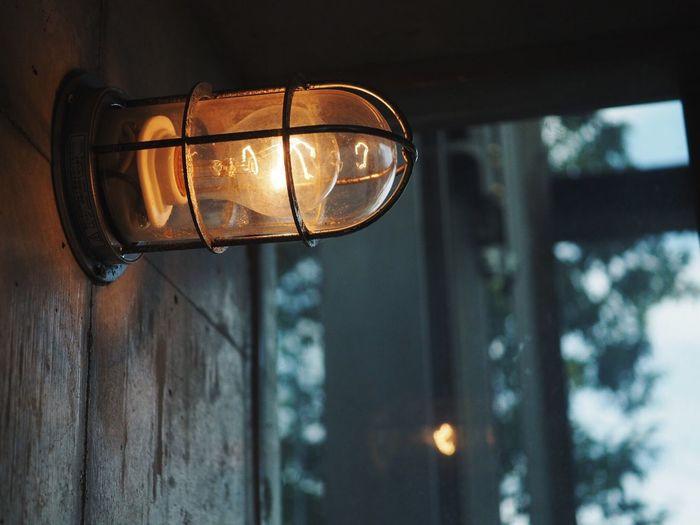 Illuminated Light Bulb Mounted On Wall
