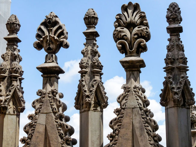 Carved Stone Architecture Buildings Carved Cathedral Close-up Columns Day Detail Intricate Italy Milan No People Outdoors Part Of Religious Architecture Sky Stonework