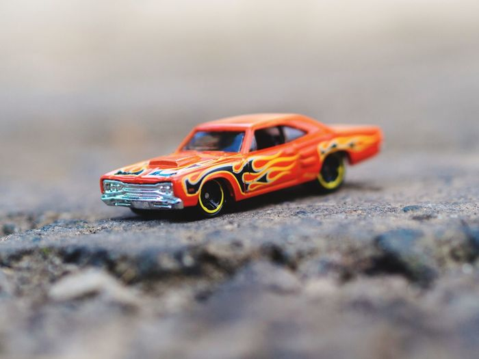Close-up of toy car on rock