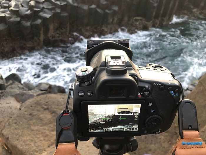 Capturing the waves Technology Photography Themes Camera - Photographic Equipment Activity Sea Nature Land People Close-up Outdoors Photographic Equipment Aquatic Sport Photographing Day Front View Camera Digital Camera Beach Water