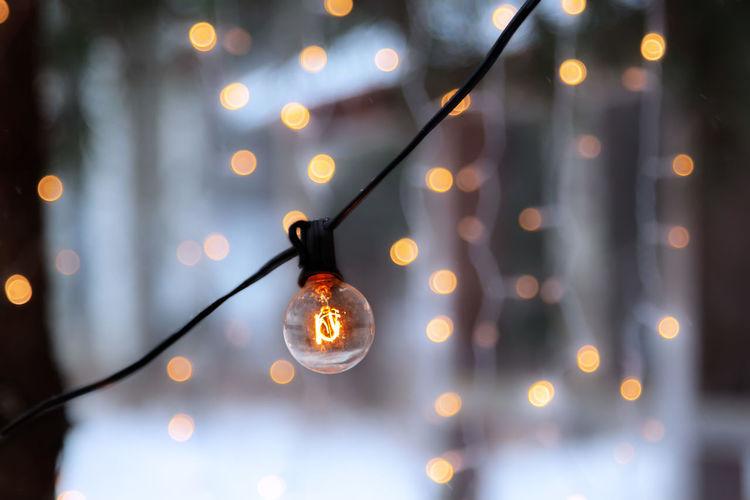 Low angle view of illuminated light bulbs