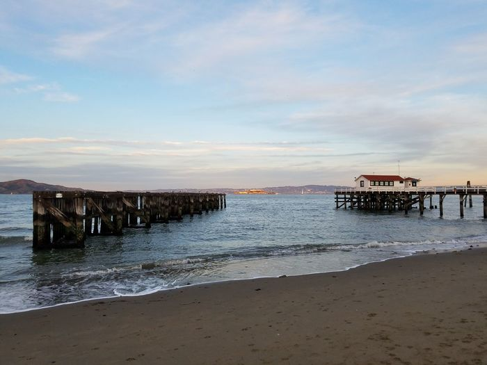 Beach Water Outdoors Horizon Over Water Built Structure Pier Sand Sky Cloud - Sky Day Nature Sunset Building Exterior Architecture No Filter/no Edit Lost In The Landscape Tranquil Scene San Francisco Bay Waters Scenics Backgrounds Alcatraz Island Military Prison Labor Built