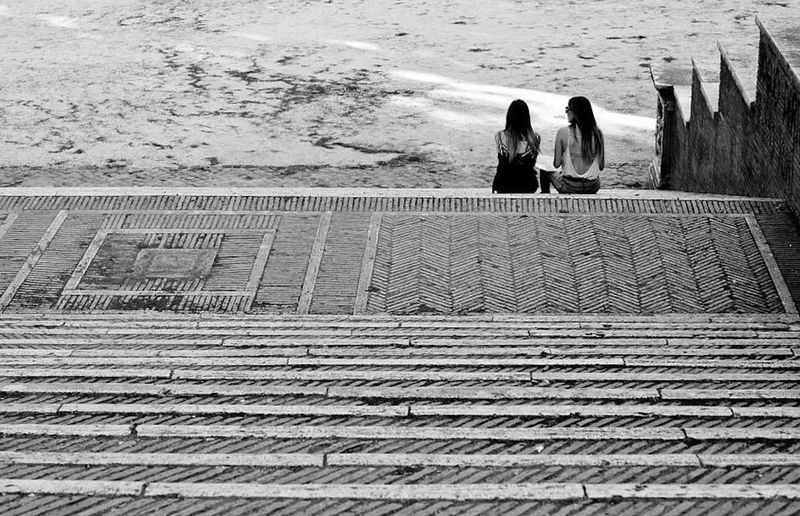 Two of us Real People Lifestyles Women Leisure Activity Outdoors Togetherness Together Two Twoofus Streetphotography Cityphotography City Blackandwhite Photography Adapted To The City