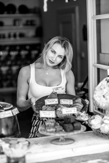 Portrait of young woman working in food store