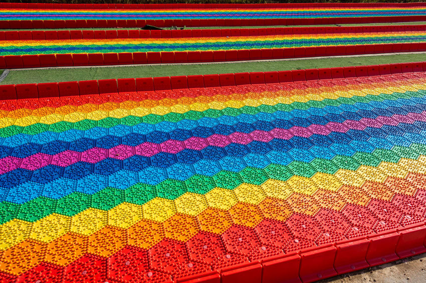 Loring features a colorful grass track Colors Colorful Features Field Freedom Grass Grass Slide Hillsides Loring Park Mountains Natural Outdoors Outskirts Playgrounds Projects Rainbow Rainbow Colors Relaxing Tourism Multi Colored Pattern Backgrounds No People Vibrant Color Close-up Creativity Art And Craft Red Full Frame Variation Textured  Indoors  Choice Design Day Striped In A Row Textile Built Structure Ornate Saturated Color Textured Effect