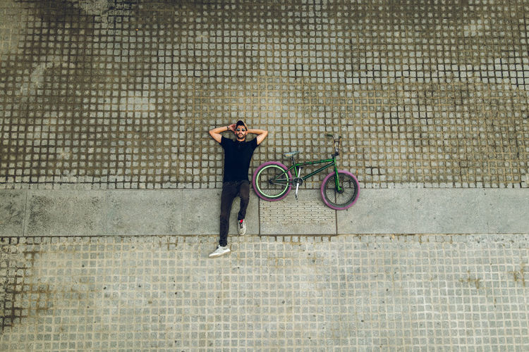 Man riding bicycle on footpath