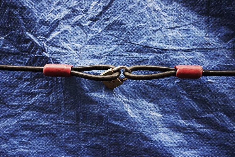 Metal hooks interlocked with padlock