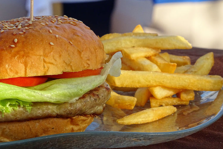 Hungry at the Beach Bun Burger CheeseBurger Close-up Fast Food Fast Food French Fries Food Food And Drink French Fries Freshness Fried Hamburger Indoors  No People Potato Prepared Potato Ready-to-eat Sandwich Snack Still Life Table Take Out Food Tray Unhealthy Eating Vegetable