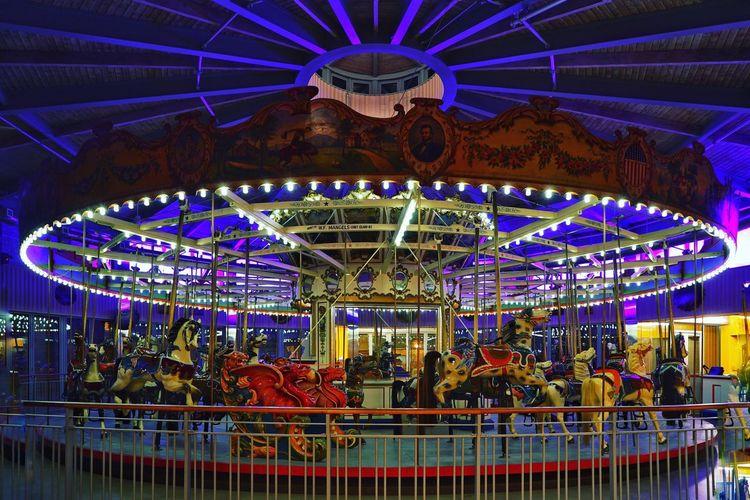 Illuminated carousel at night