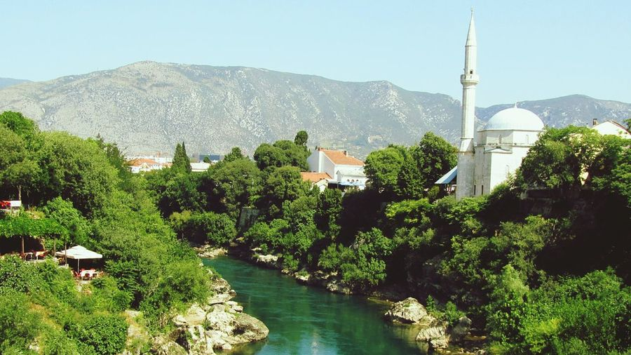 Mostar Water Mountain Tree Built Structure Islam Scenics Mountain Range House Tranquility Non-urban Scene Travel Destinations Bosnia And Herzegovina Beauty In Nature Nature