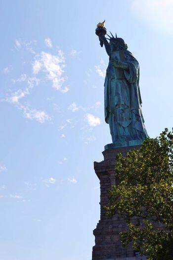 Battle Of The Cities Lady Liberty watching over her city. NYC Photography Freedom Statue Low Angle View Famous Place Cloud - Sky National Landmark