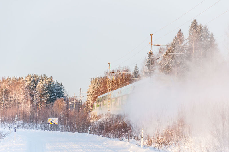 Train whirling snow in Winter Snow ❄ Train Tracks Winter Cable Clear Sky Cold Temperature Day Electricity Pylon Nature No People Outdoors Sky Snow Train Train - Vehicle Transportation Tree Whirling Winter Winter Trees