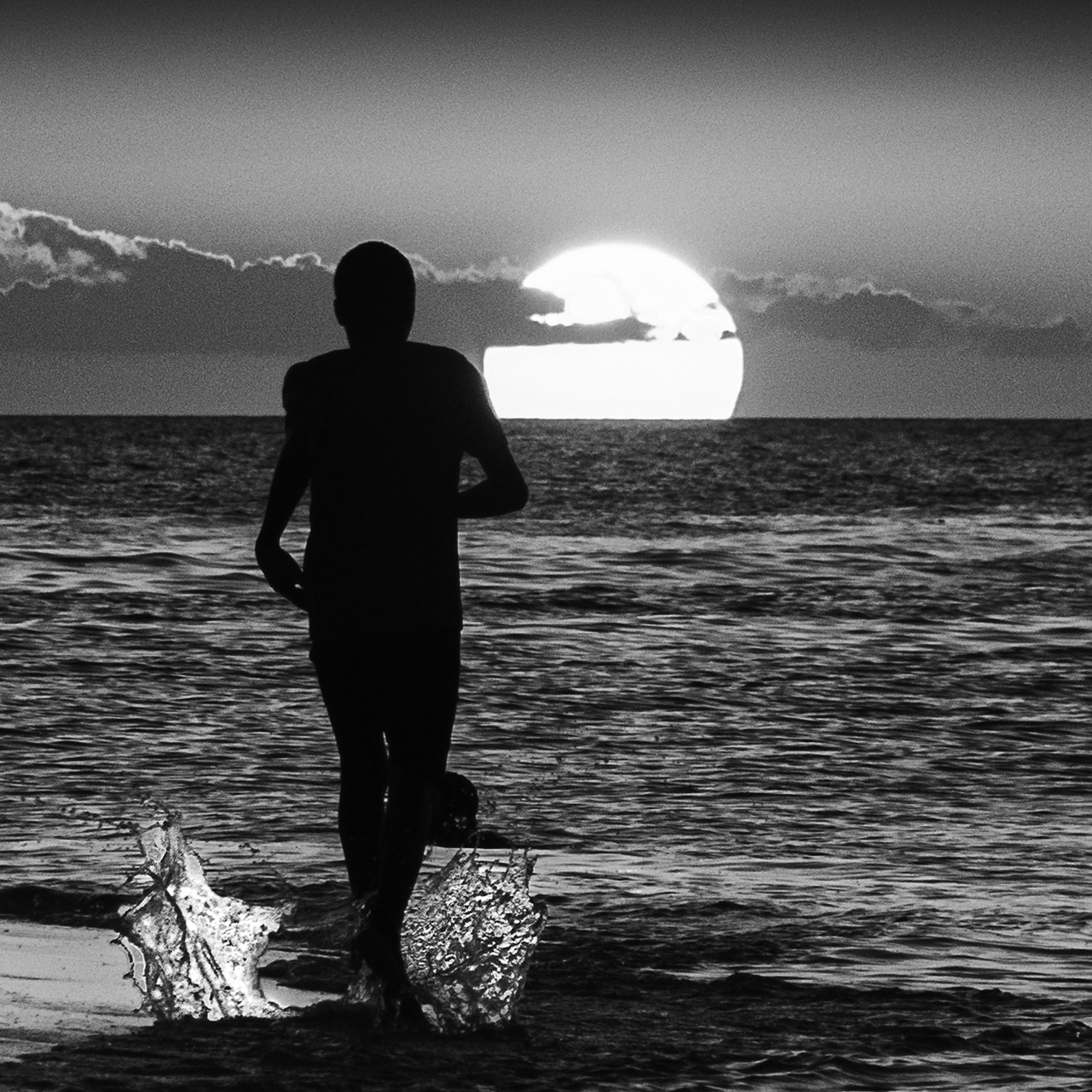 water, sea, real people, sky, standing, rear view, one person, beauty in nature, scenics - nature, lifestyles, nature, beach, full length, leisure activity, land, rock, men, rock - object, outdoors, horizon over water, looking at view