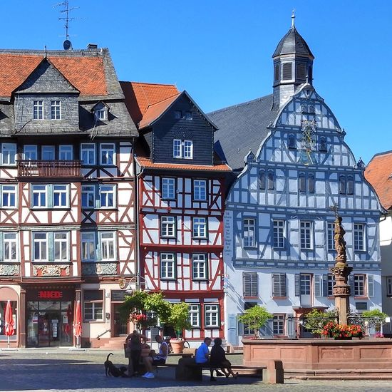 Colorful halftimbered houses in Butzbach, Germany Colorful Incidental People Half-timbered Building Exterior Architecture Built Structure Building Day Sky Window Street City