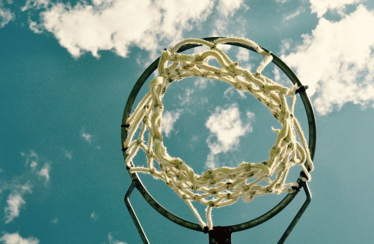 View from below of a netball hoop and stand with a blue sky and cloud background in Western Australia. Abstract Australian Sports Basketball Basketball Hoop Blue Cloud Cloud - Sky Day Dreaming Hoop Low Angle View Net Netball Outdoors Perspective Pole Rope Sky Sports Sports Photography Team Sport The Color Of Sport View From Below Western Australia Woven