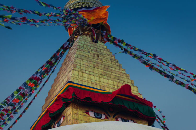 Boudhanath Stupa World Heritage Site By UNESCO Architecture Art And Craft Belief Building Building Exterior Built Structure Clear Sky Day Decoration Flag Low Angle View Multi Colored Nature No People Ornate Outdoors Place Of Worship Religion Sky Spirituality