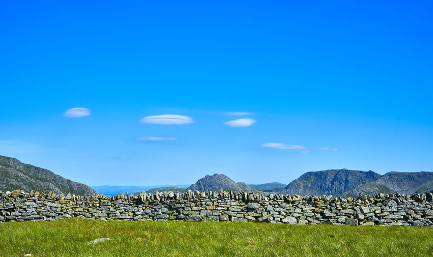 Views from the summit of the Snowdonia mountain range in North Wales, UK, Beauty In Nature Blue Blue Sky Day Landscape Landscapes Mountain Mountain Range National Park Nature No People Outdoors Rock - Object Scenics Sky Snowdonia Stack Summit Tranquil Scene Trekking Wales Wales UK Wales❤