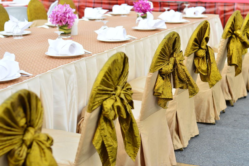 Close-up of arranged dining table at wedding ceremony