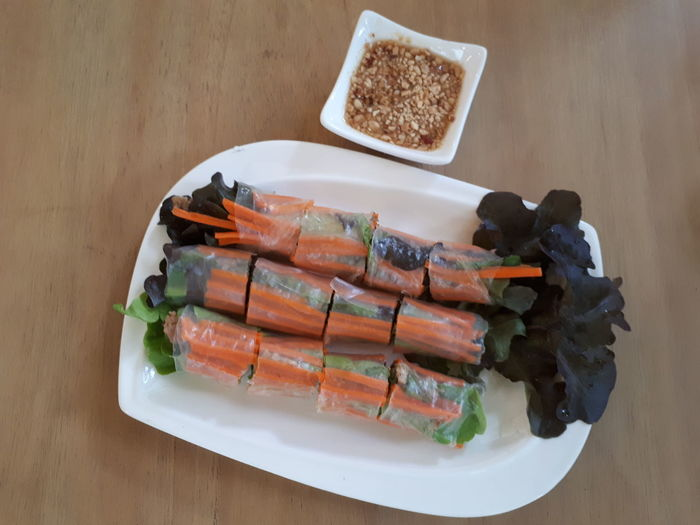 Authentic Vietnamese fresh spring herb recipe in day spa's province Thailand. Authentic Spring Roll Fresh Vietnamese Food Organic Food Herb Health Conscious Vegetable Delicious Appetizer Asian  Favorite Dipping Sauce Menu Gourmet White Plate Wrapped EyeEm Selects Food Fish Freshness Food And Drink Plate Healthy Eating High Angle View Table Ready-to-eat Close-up No People