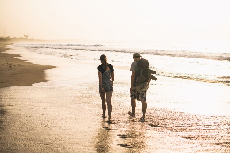 Sea Water Beach Land Two People Rear View Leisure Activity Full Length Real People Togetherness Bonding Lifestyles Sky Men Sand Women Nature Walking Motion Couple - Relationship Horizon Over Water Positive Emotion EyeEm Best Shots EyeEmNewHere EyeEm Selects