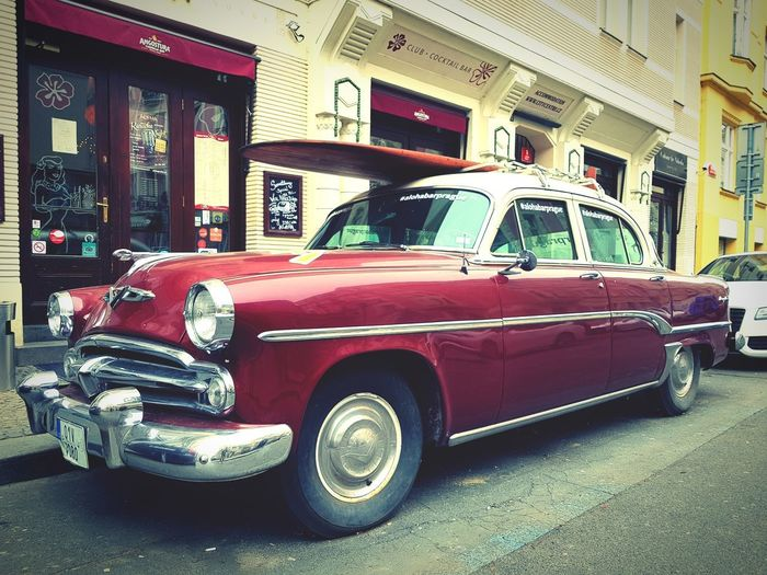 Vintage car parked on street in city