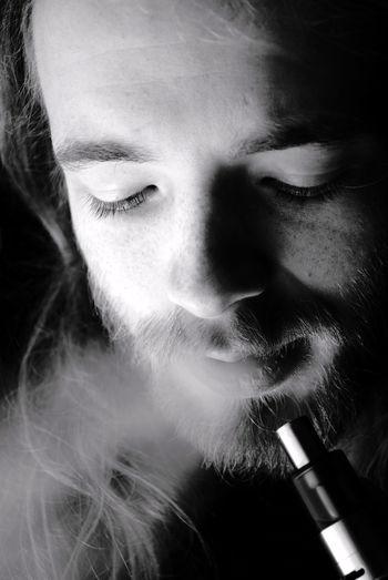 Close-up of man smoking