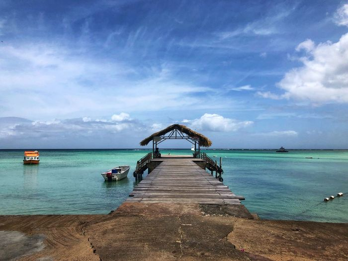 Waiting for the glass bottom boat ChannelBMedia Travel Tourist Water Sky Sea Beach Land Cloud - Sky Beauty In Nature Scenics - Nature Nature Tranquility Tranquil Scene Horizon Over Water Day Horizon Pier Transportation Sand Direction Idyllic Outdoors