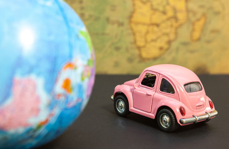 Close-up of toy car and globe on table