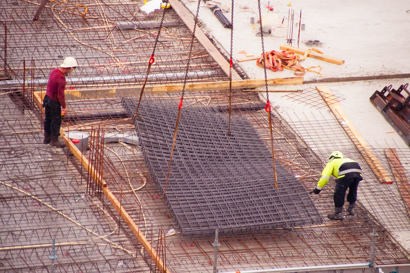 High angle view of men working at construction site