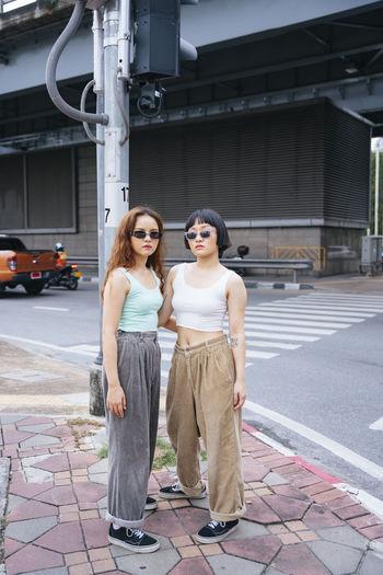 Full length of lesbian couple standing on road