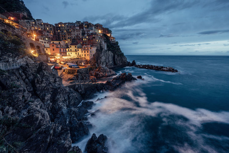 Sea Water Scenics Horizon Over Water Tourism Cliff Nature Travel Destinations Vacations Blue Dusk Italy Cinque Terre Manarola Sky Tranquil Scene Vacations Relaxation Sunset