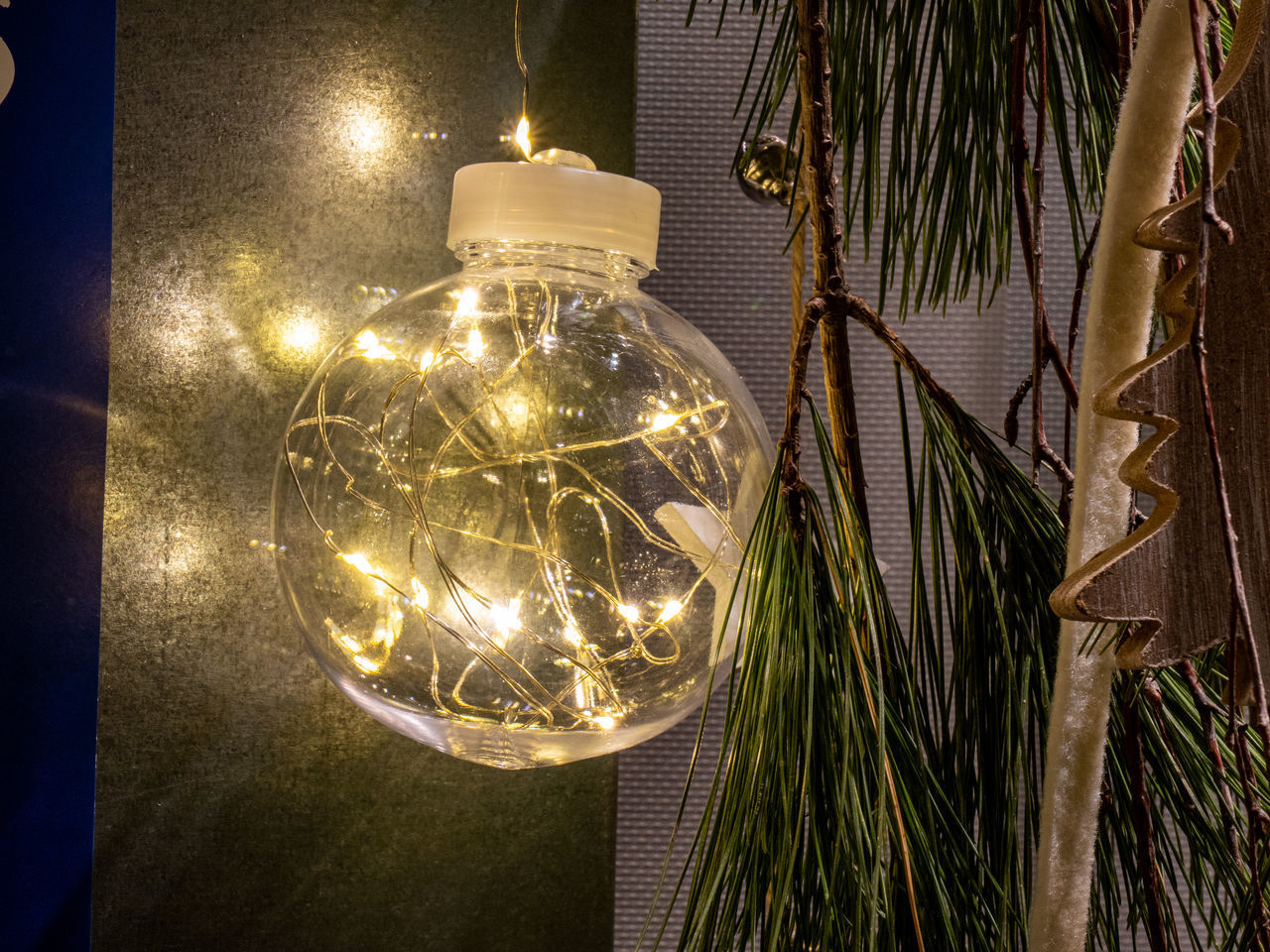 illuminated, electricity, lighting equipment, hanging, electric light, indoors, no people, light, tree, light bulb, close-up, night, glowing, decoration, plant, light - natural phenomenon, focus on foreground, christmas, celebration, christmas lights, electric lamp