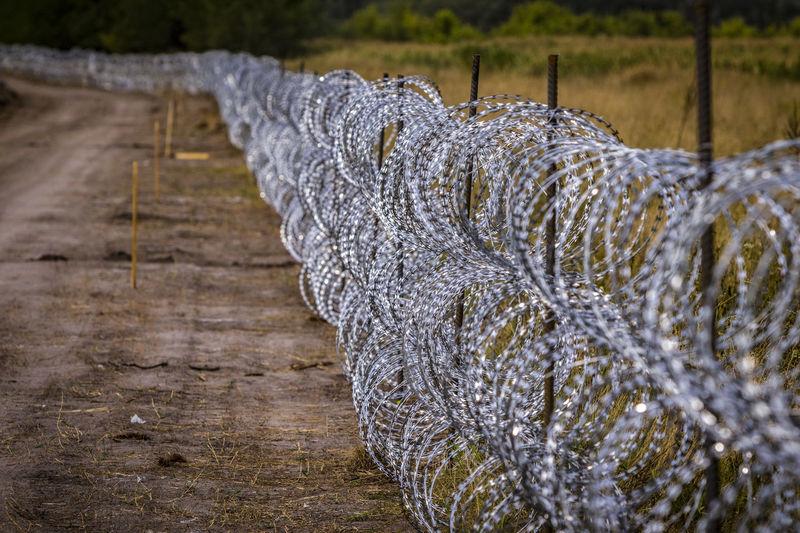 Razor wire fence by field