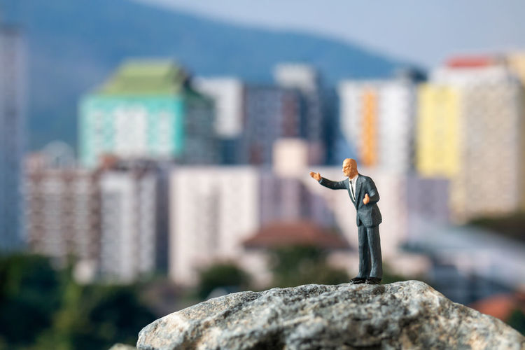 Close-up of stuffed toy on rock in city