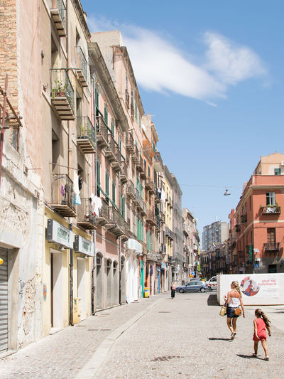Cagliari, Italy - August 17, 2016: The characteristic architecture of buildings in the old quarter of Cagliari, Italy. Architecture Avenue Background Beautiful Building Buildings Cagliari Colorful Culture Europe European  Exterior Façade Historic Houses Italian Italy Landmark Medieval Narrow Old Outdoor Pastel Sardegna Sardinia Street Summer Town Travel Urban