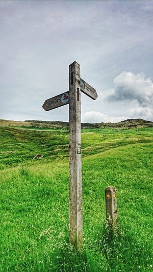 Signpost Nature On Your Doorstep Green Color Tranquil Scene Countryside Away From The City Hillside Cross Religion Grass No People Outdoors Day Green Color Sky Walking Greenfield, United Kingdom.