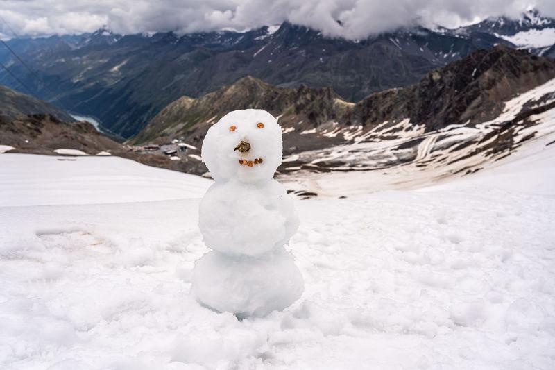 White snow on mountain against snowcapped mountains