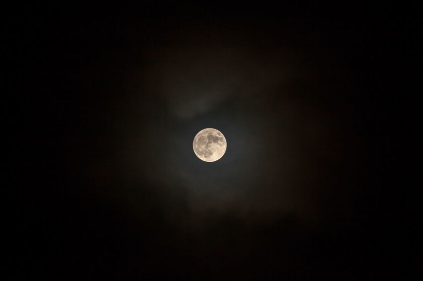 Moon poking through clouds Astronomy Beauty In Nature Low Angle View Moon Moon Surface Nature Night No People Outdoors Planetary Moon Scenics Sky Space Tranquil Scene Tranquility