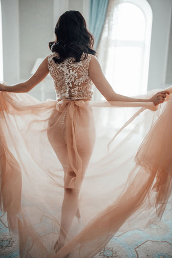 Rear view of woman wearing bridal clothing at home