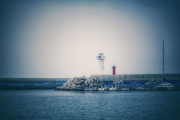 Korea Photos Jejudo JEJU ISLAND  Jeju Harbor Light House Travel Landscape Blue Freshness Scenics Sea Lighthouse Dock Clear Sky Outdoors Tranquility No People Sky Nautical Vessel Architecture Nature Horizon Over Water Beauty In Nature Streamzoofamily