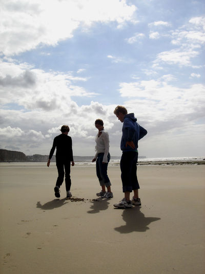 Three friends at the beach. Beach Cloud - Sky Day Friendship Full Length Group Of People Leisure Activity Lifestyles Nature Positive Emotion Sand Sky Togetherness Water
