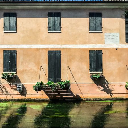 ShotOnIphone Buranelli Treviso Canal Built Structure Architecture Building Exterior Window Day No People Water Nature Residential District Art And Craft Reflection Outdoors Graffiti Wall - Building Feature Creativity Waterfront Sunlight Building Wall