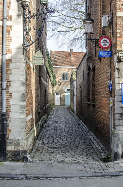 Brick by brick in Brugge Alley Architecture Bricks Building Exterior Built Structure City Street The Way Forward
