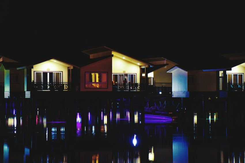Living On The Water Floating Hotel Floating On Water On The Sea Water Reflection Illuminated Architecture No People Scenics Outdoors Floating Rooms Sea Building Exterior Darkness And Light Darkness Beauty Of The Night Colors Colorfull Sea At Night Rooms Dark Photography Night Lights Nightphotography Nighttime Welcome To Black EyeEm Diversity See The Light