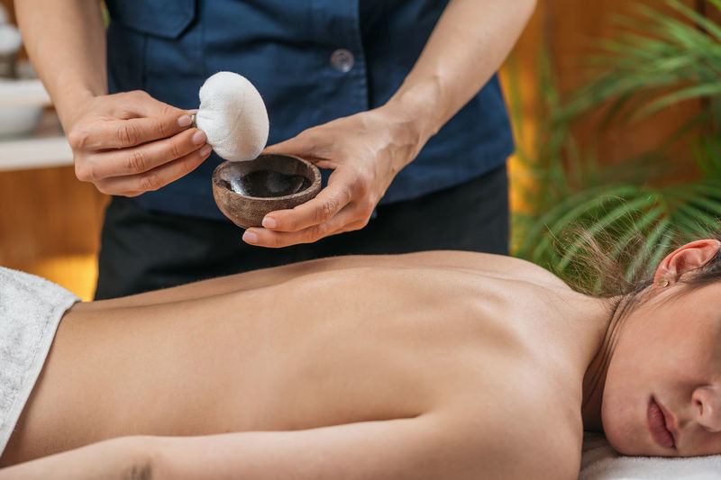 Kizhi or herbal bags ayurveda massage.