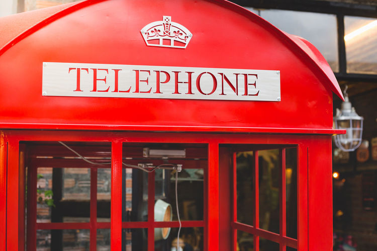 Traditional old style UK red phone box in London. Antique London Retro Travel Architecture Capital Letter Close-up Communication Communications Tower Convenience Day Old Pay Phone Red Sign Telephone Telephone Booth Text Vintage Western Script