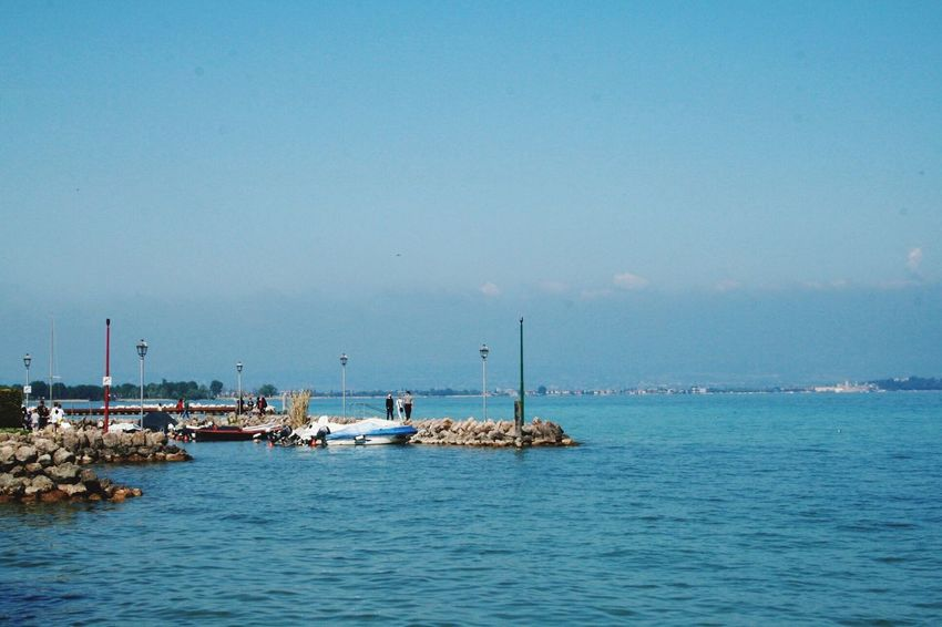 PeschieraDelGarda Gardasee Italy Holidays Lombardy Water Reflections Water Surface Blue Sky Blue Background People Photography Nature Photography Eyem Gallery Eyemphotos
