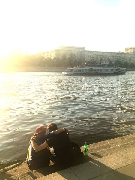 Soaking Up The Sun Enjoying The Sun Relaxing Getting In Touch Moscow Moscow Life Couple Friendship Friends Riverside Riverbank From My Point Of View Closeness Intimacy Unrecognizable People Lovers Capture The Moment Atmosphere City Life Communication People And Places