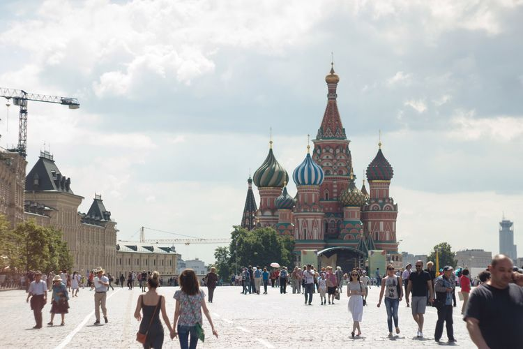 People Walking On Road Against St Basil Cathedral In Red Square